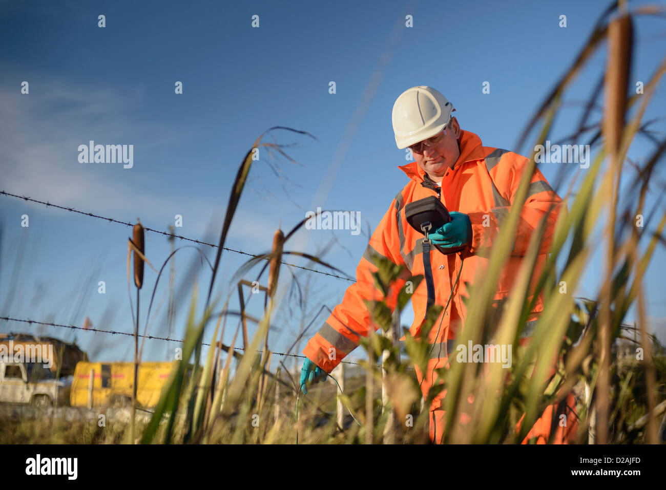 Worker monitoring water at coal mine - Stock Image