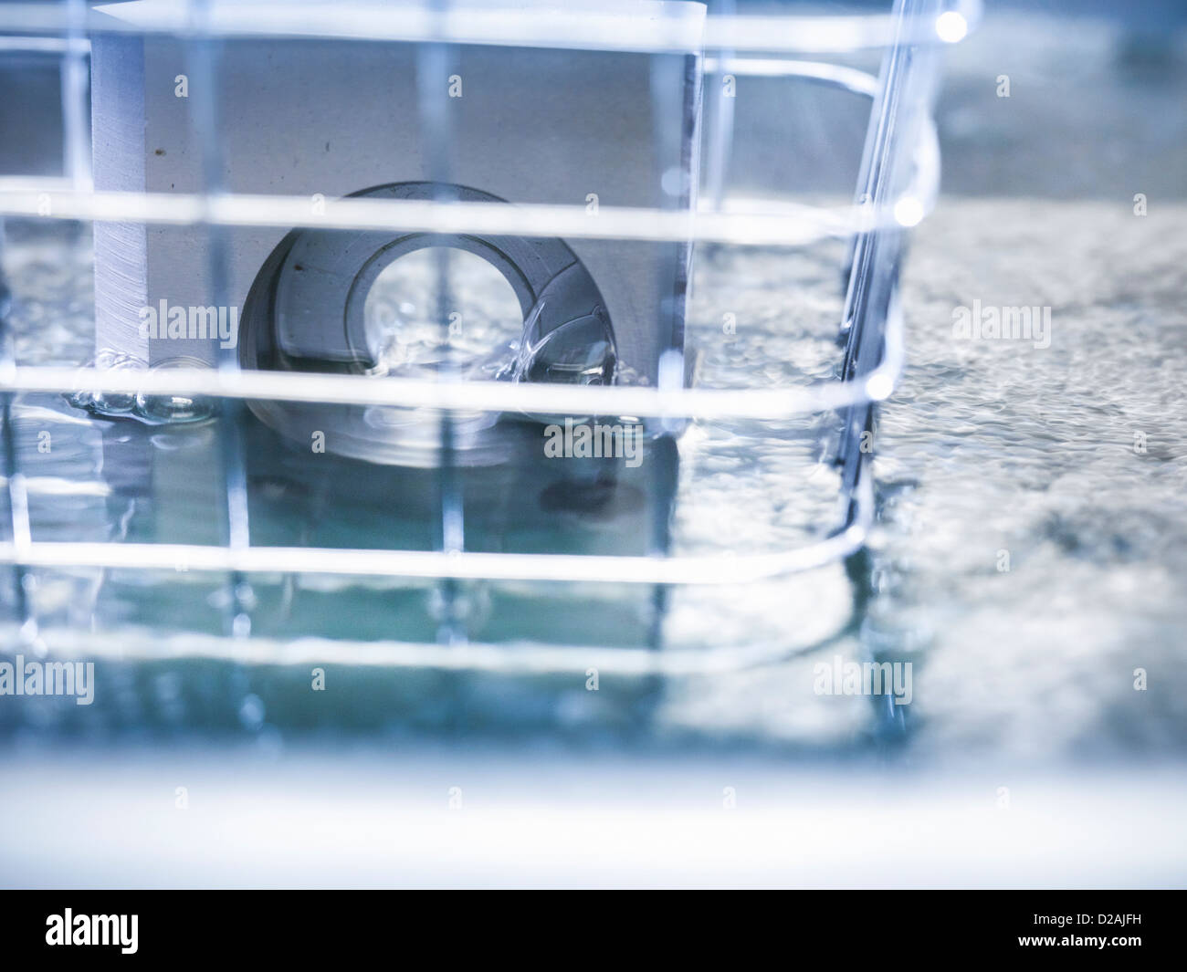 Products being cleaned with ultrasonics - Stock Image