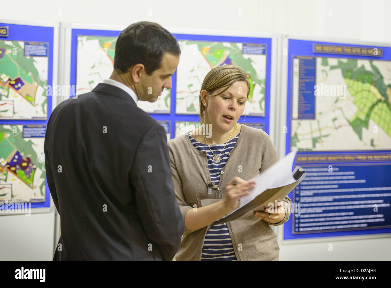 Woman talking with town hall staff - Stock Image