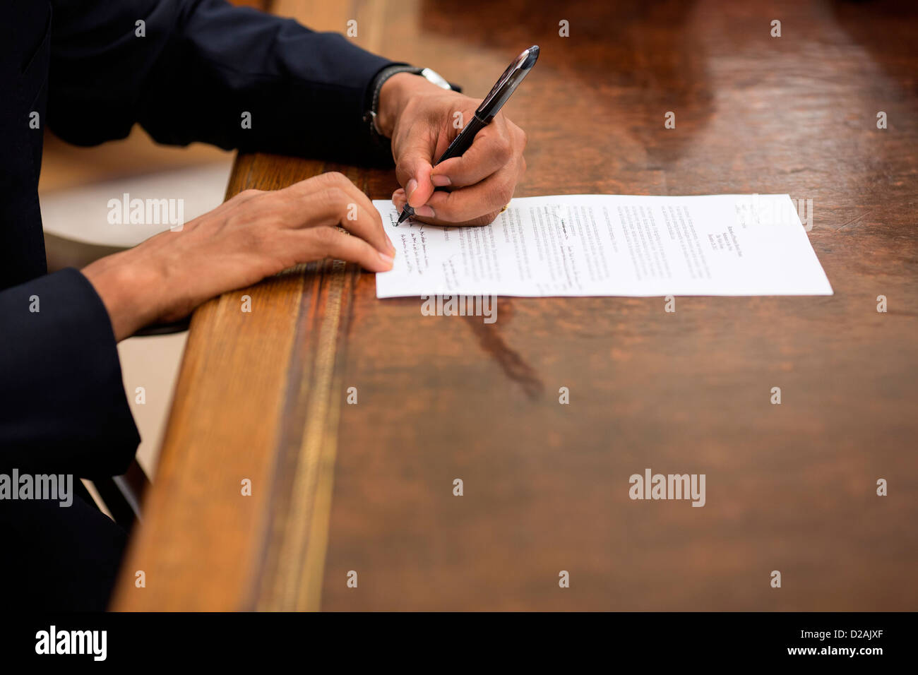 US President Barack Obama edits a statement to the press in the Oval Office of the White House December 28, 2012 - Stock Image