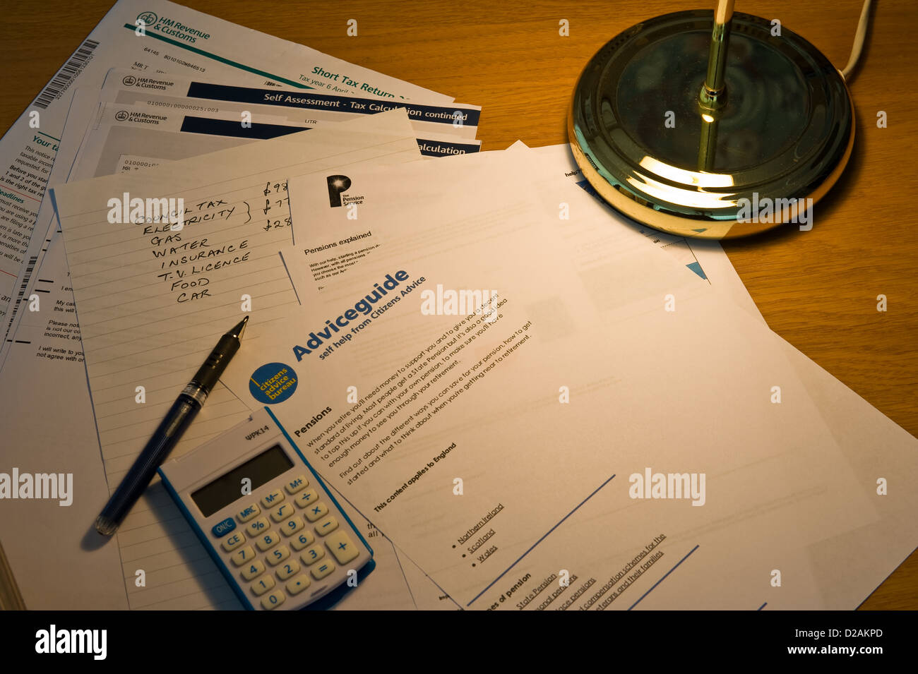 Calculating household expenses. - Stock Image