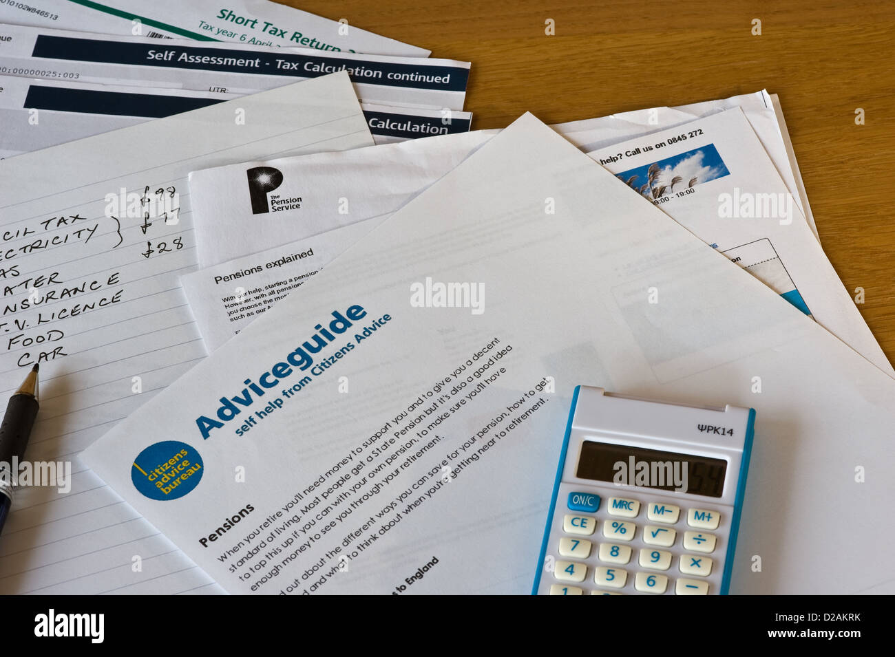 Calculating household expenses. Stock Photo