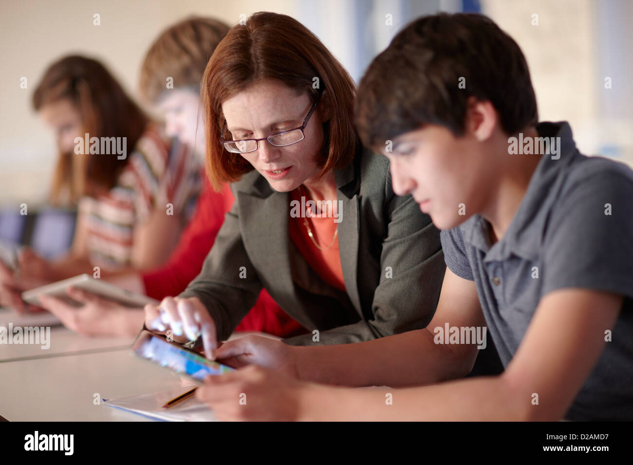 Student and teacher with tablet computer - Stock Image