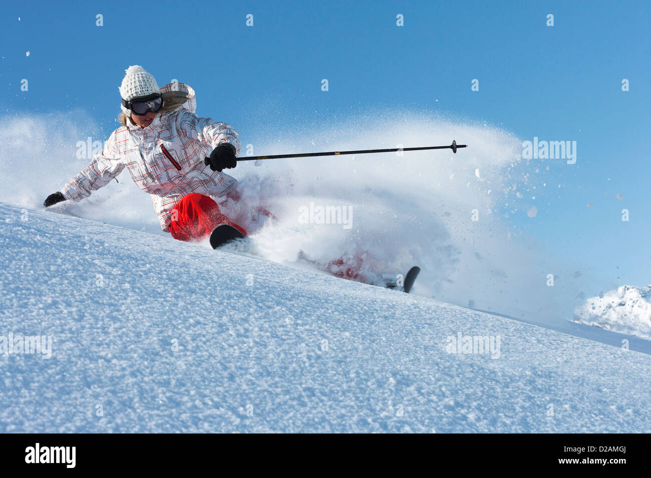 Skier on snowy slope - Stock Image