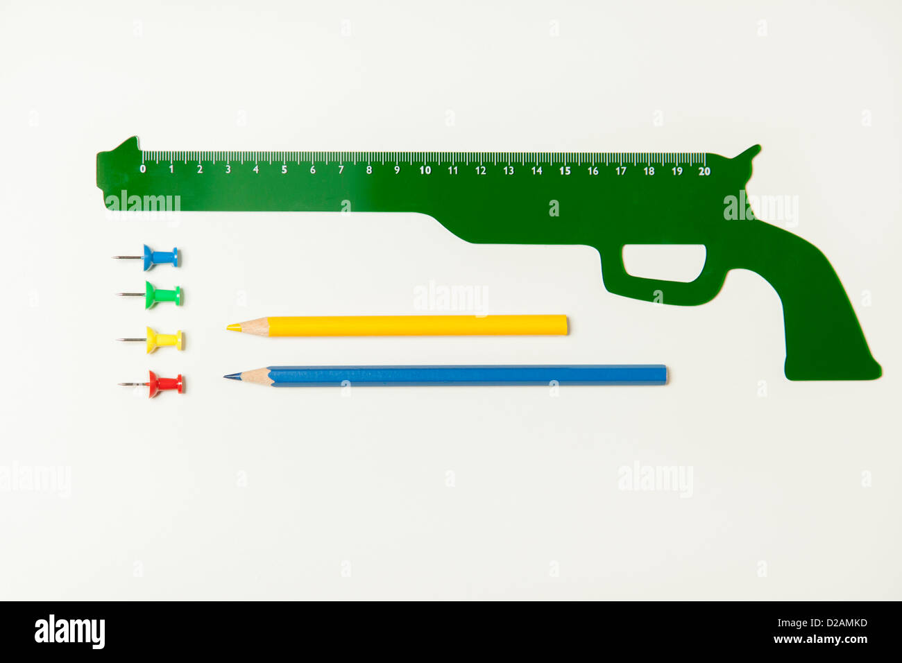 Gun shaped ruler and office supplies - Stock Image