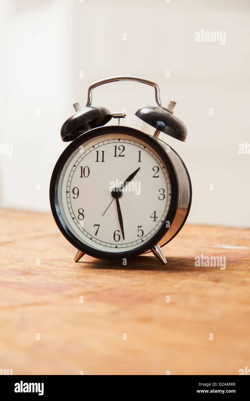 Alarm clock on wooden table - Stock Image