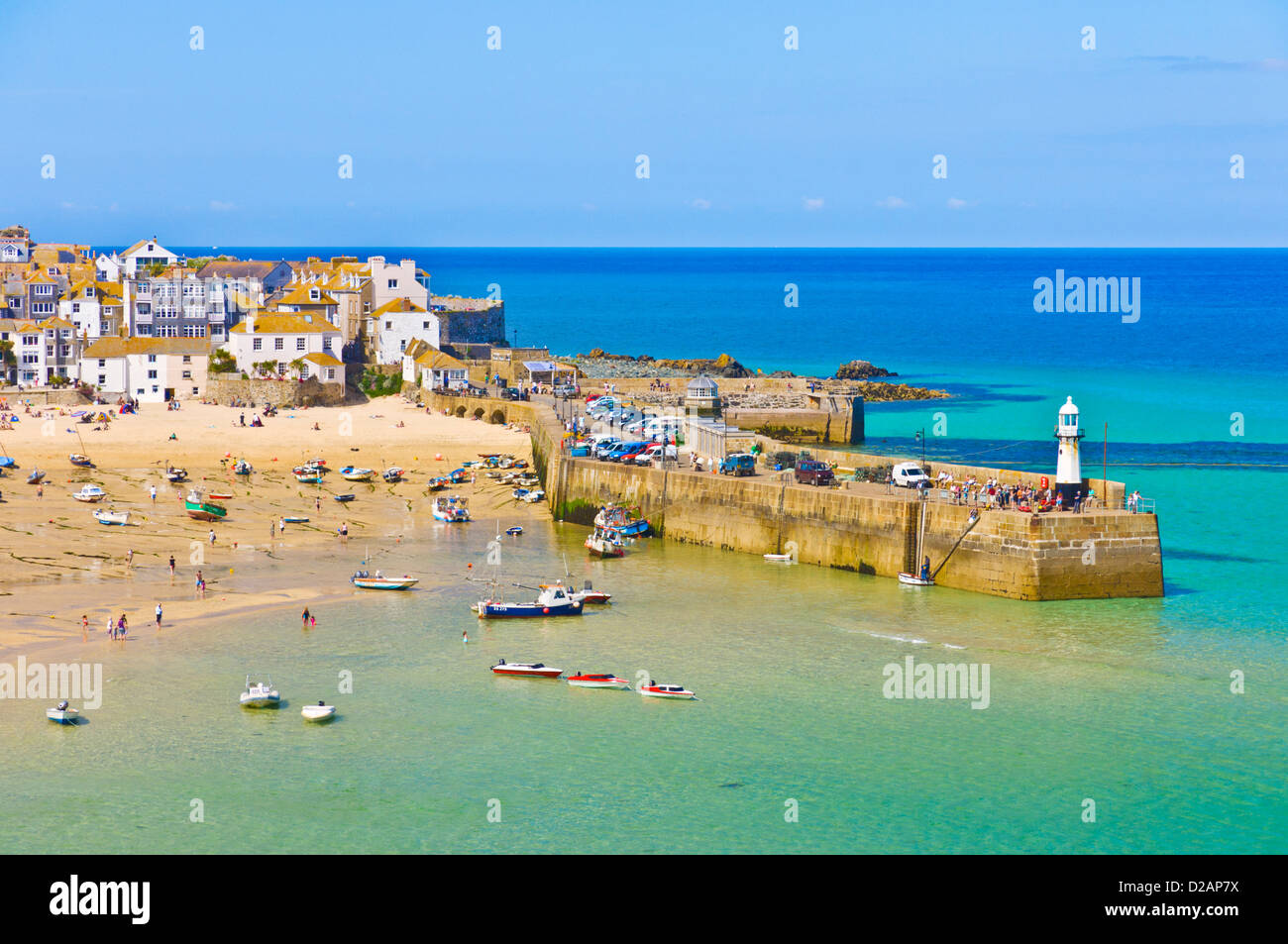 holidaymakers on the beach at The Island or St Ives Head St Ives Cornwall England GB UK EU Europe - Stock Image
