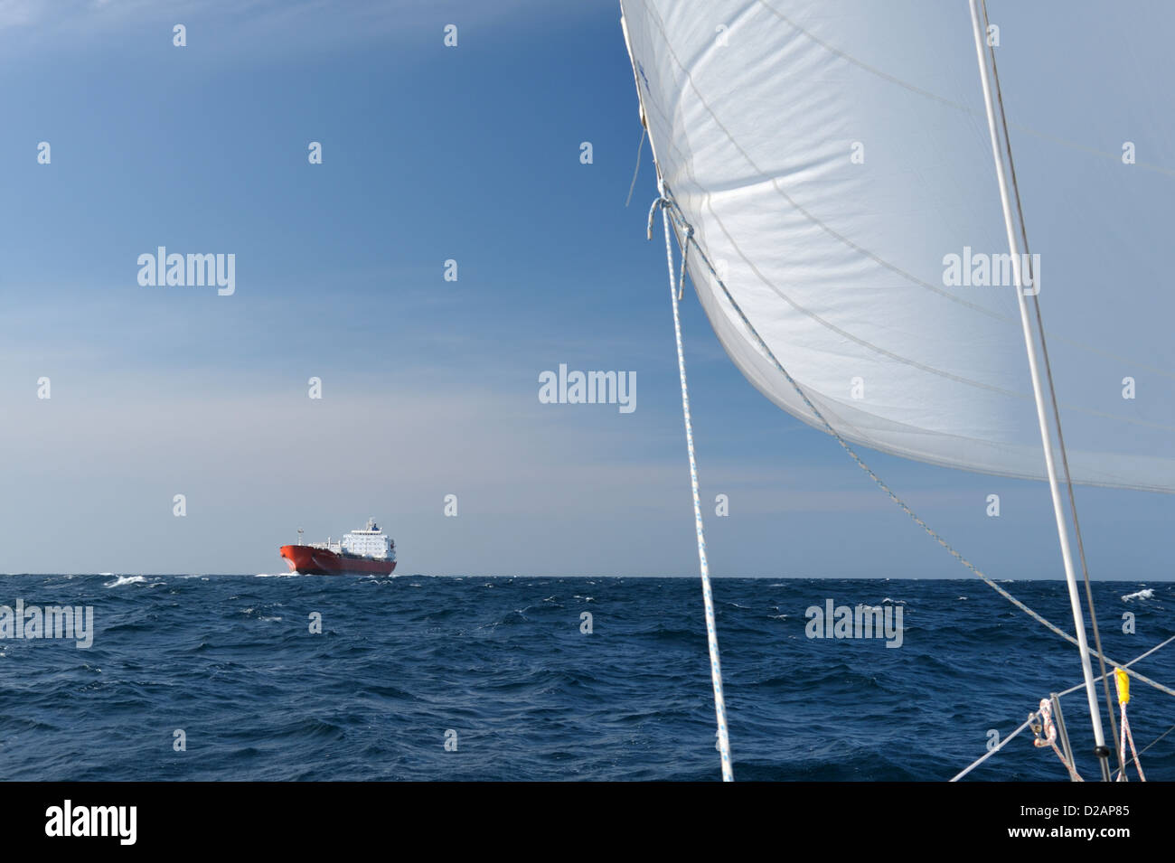 Reasons for keeping a look out. A cargo boat which came within an estimated 1000 feet of a sailing yacht in the Stock Photo