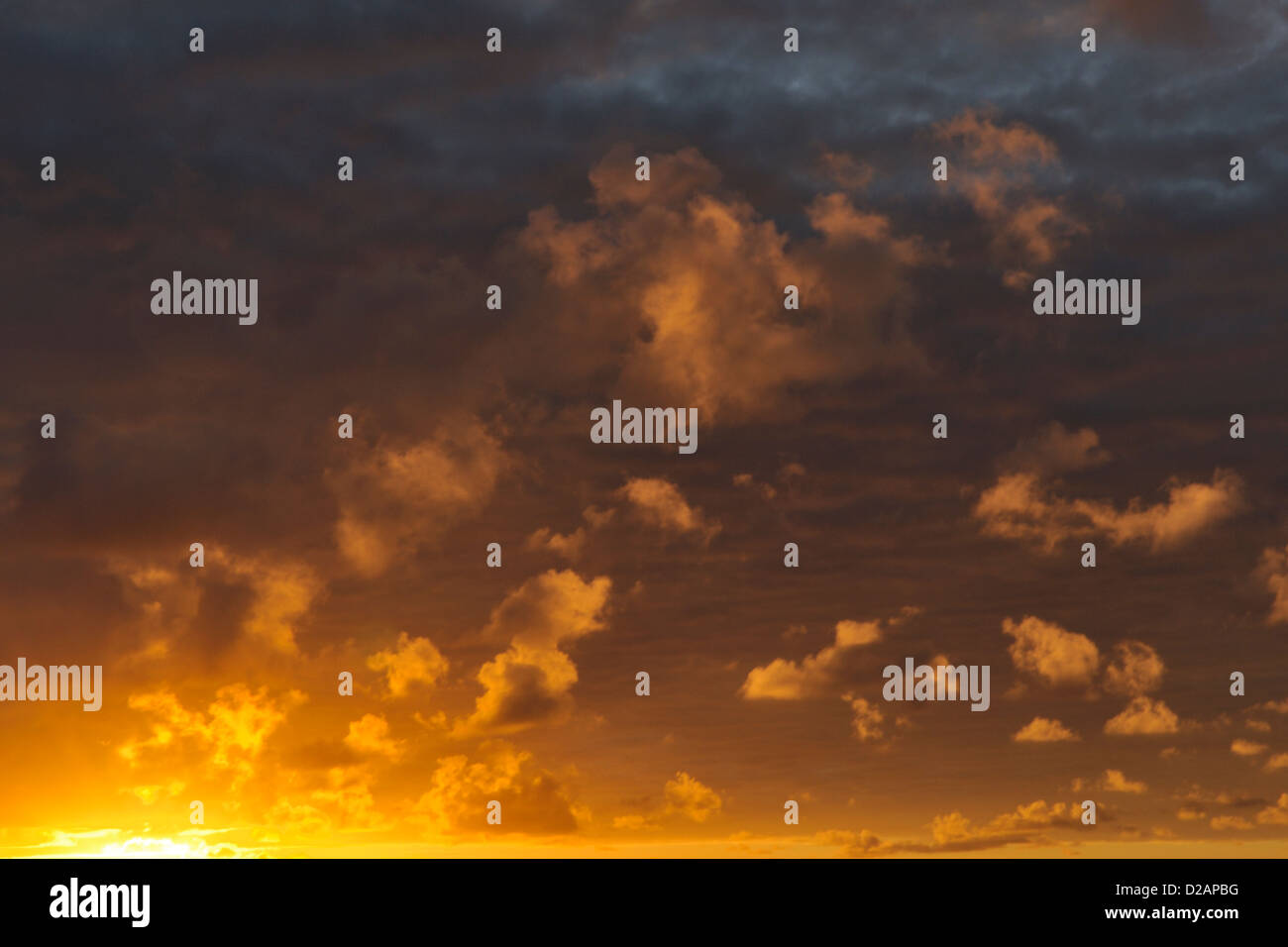 Clouds at dawn photographed from a cruising yacht on passage from Easter Island to Marquesas, South Pacific - Stock Image
