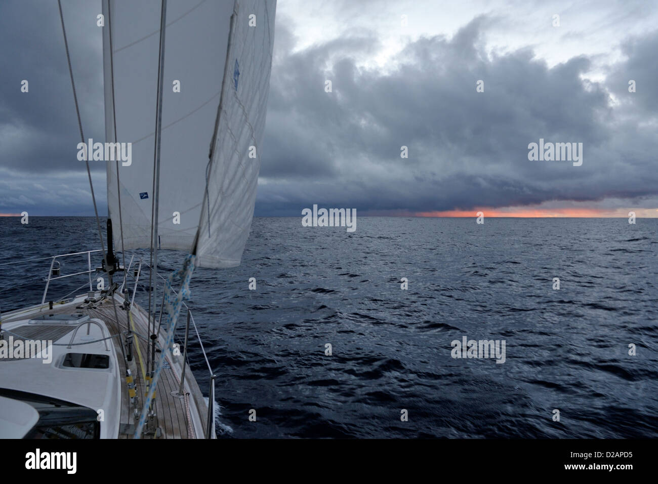 Squall ahead of a yacht, an Oyster 46, sailing alone in the South Pacific Ocean at dusk - Stock Image