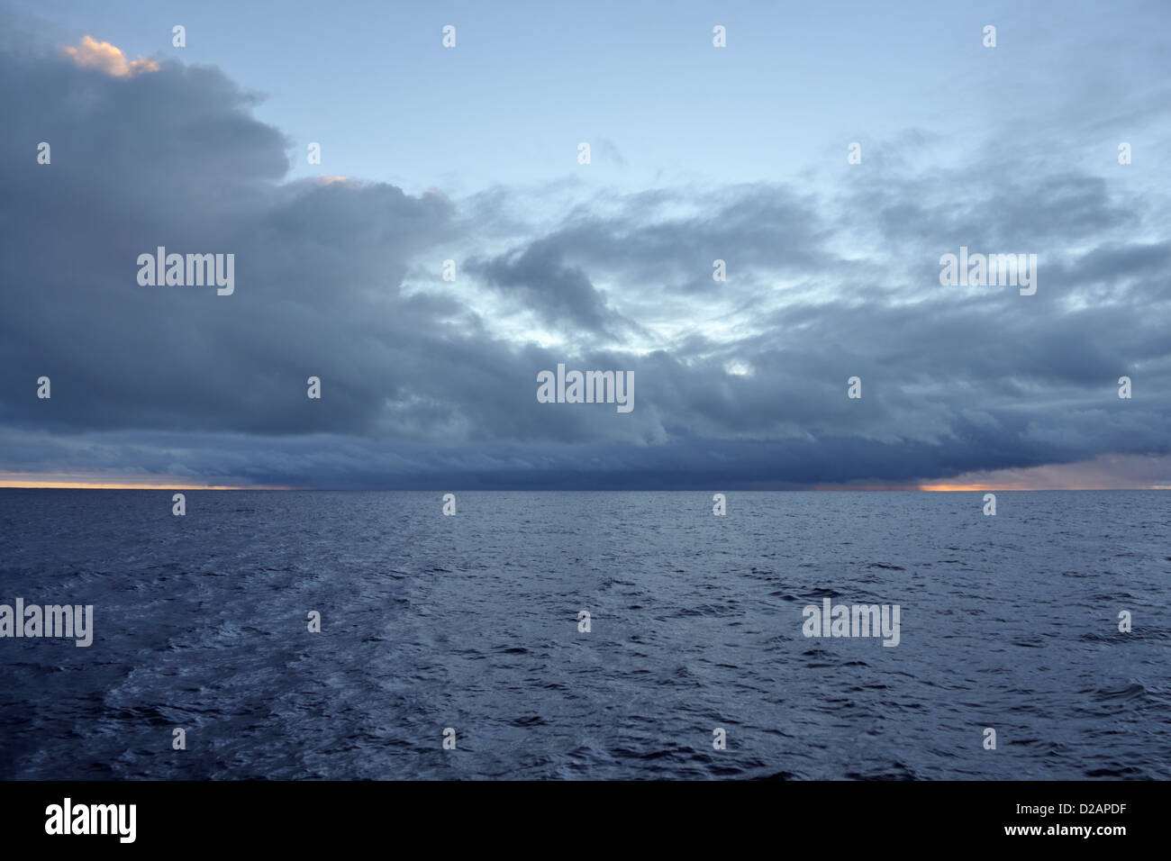 Squall line clouds ahead seen from a yacht sailing offshore in the South Pacific - Stock Image