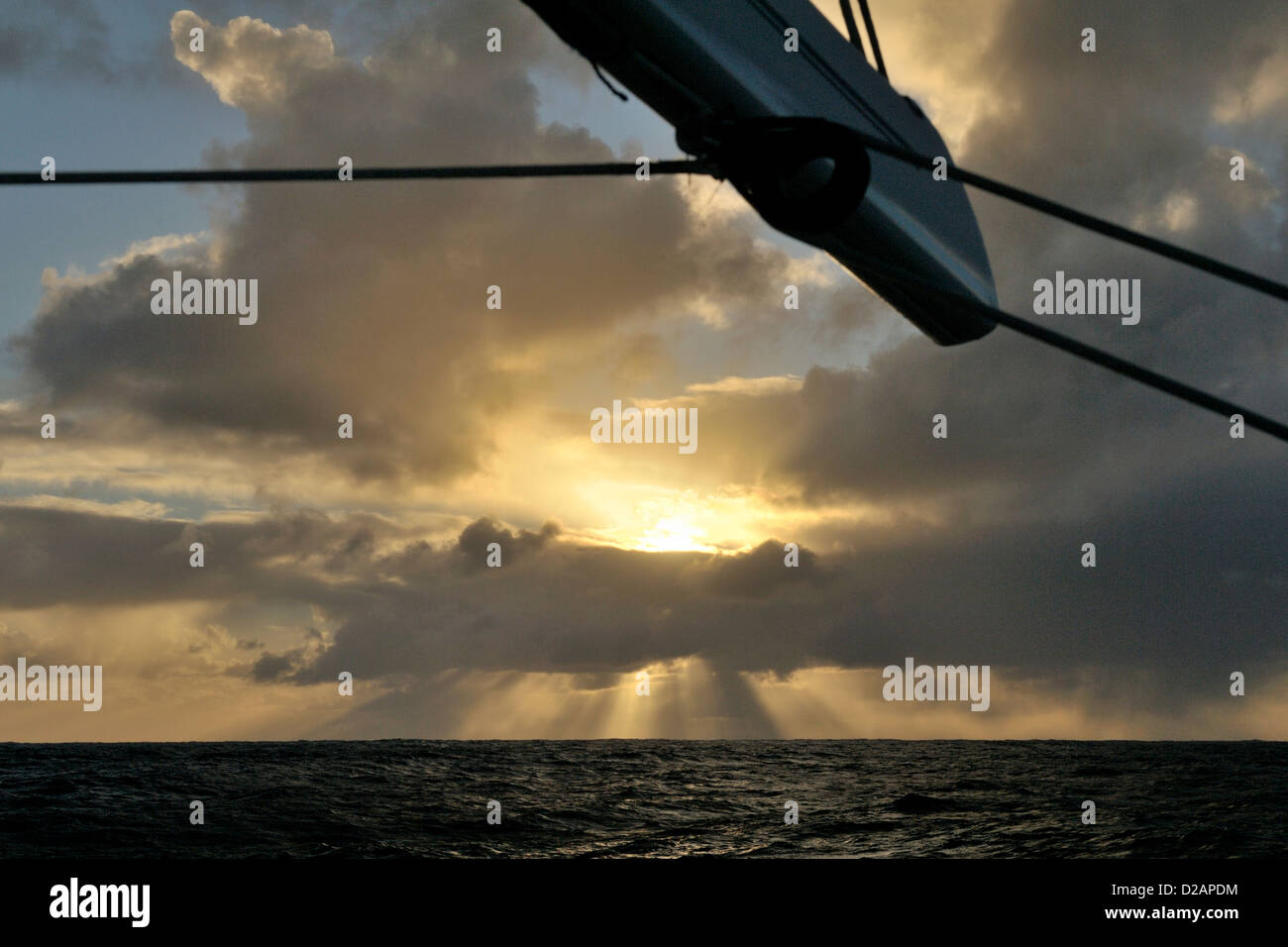 Squall alongside of cruising yacht sailing offshore in the South Pacific shortly after dawn - Stock Image