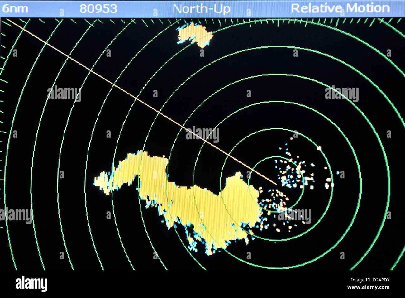 Close of or radar screen showing a squall alongside a cruising yacht sailing in the South Pacific at night - Stock Image