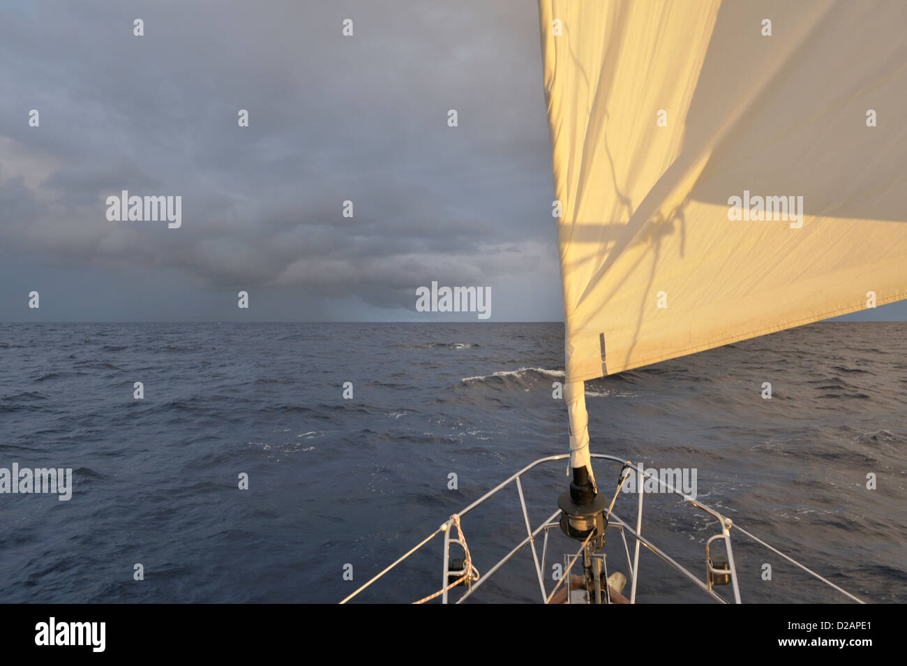 Squall ahead of a cruising yacht sailing with a reefed genoa in the South Pacific - Stock Image
