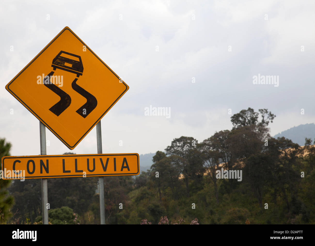 Danger sign in mexico - Slippery when Raining sign - Stock Image