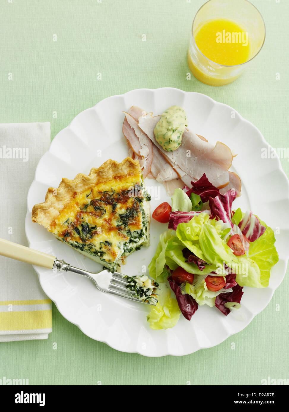 Plate of quiche, ham and salad - Stock Image