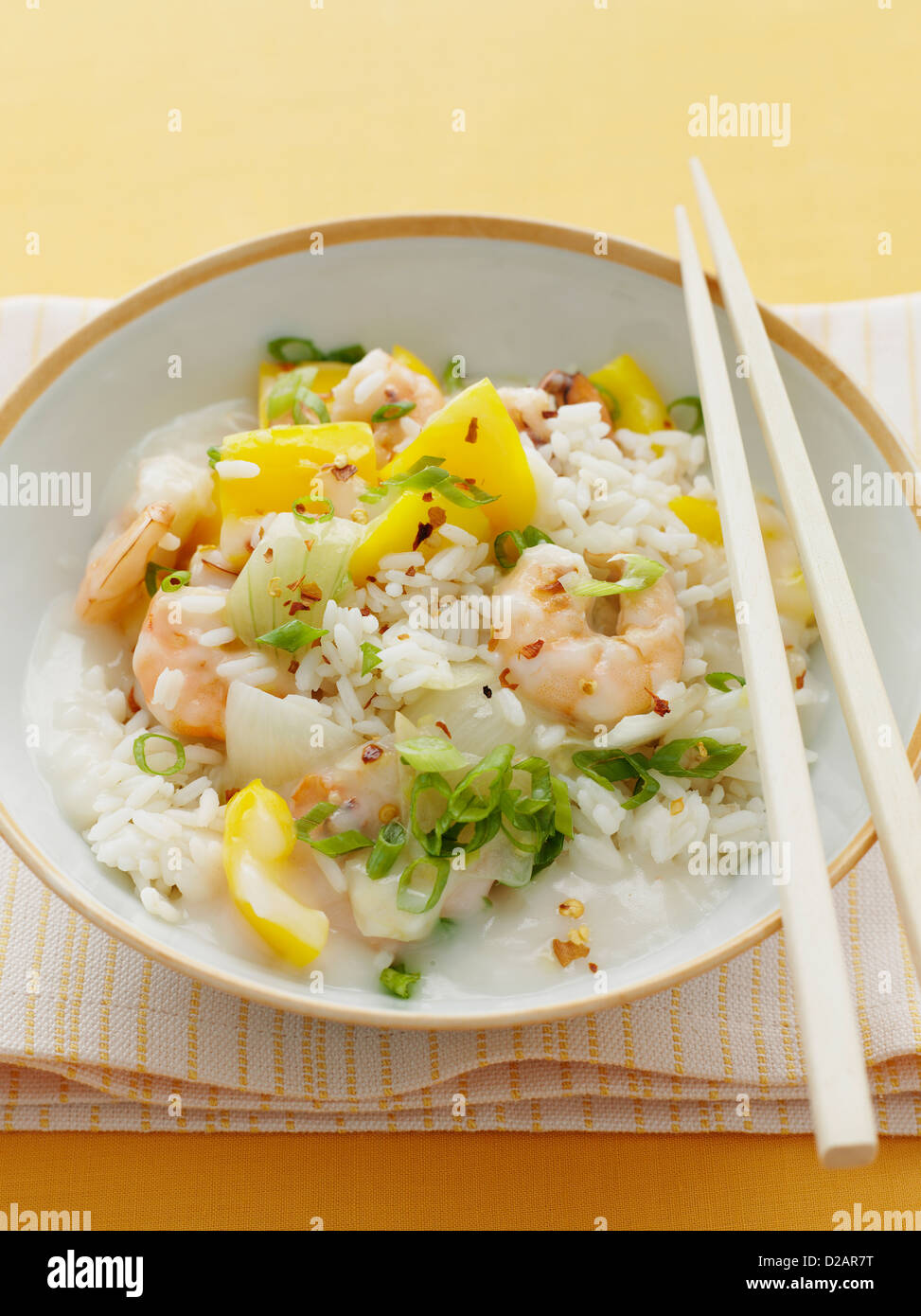 Plate of chili prawns with rice - Stock Image