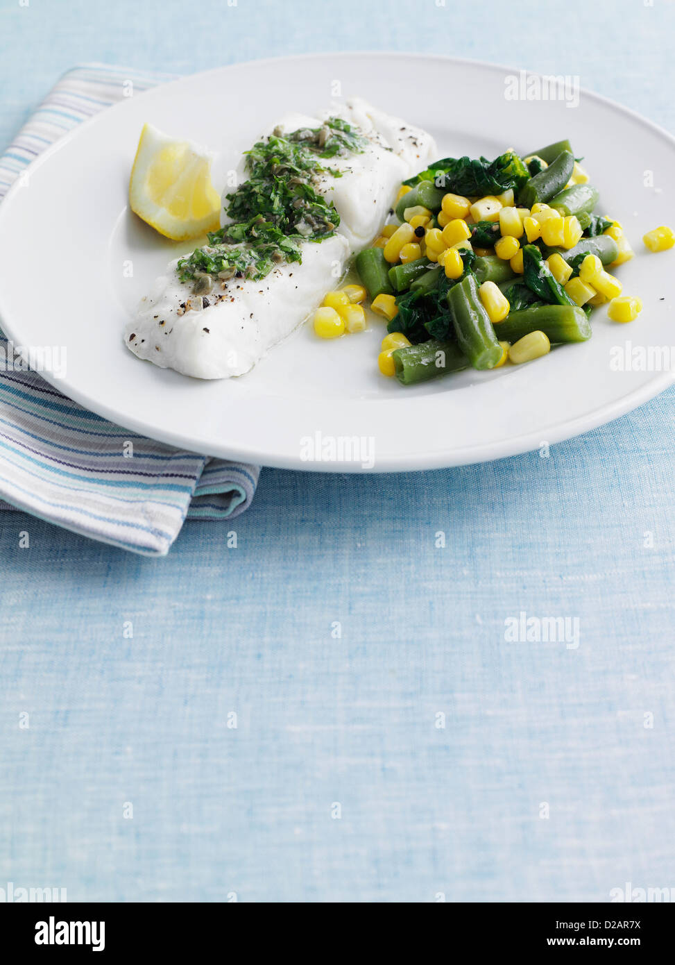 Plate of fish with beans and corn - Stock Image