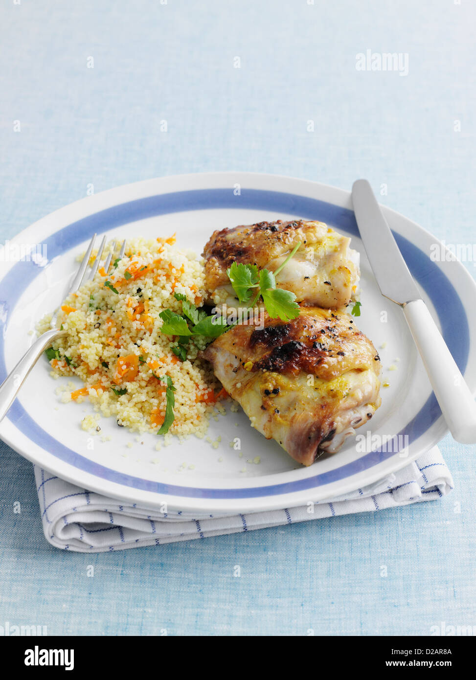 Plate of stuffed chicken with cous cous - Stock Image