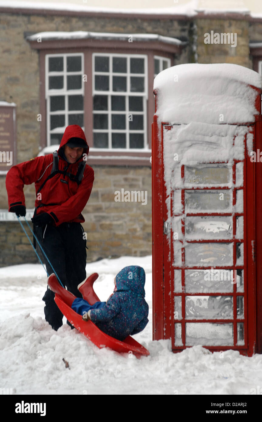 18th January 2012.  A father and daughter enjoy playing on a sledge in Kington, Herefordshire.Mark Andrews/Alamy - Stock Image