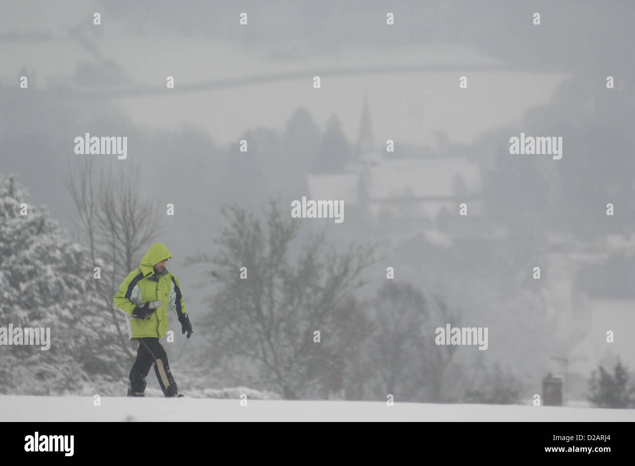 18th January 2012.  A walker hikes through snow on Bradnor Hill in Herefordshire.Mark Andrews/Alamy live news.  - Stock Image