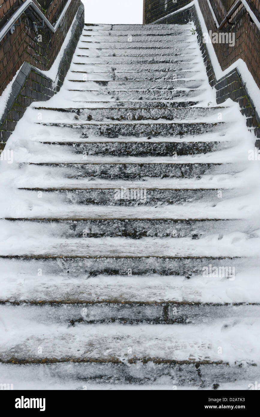 Slippery snow covered steps - Stock Image