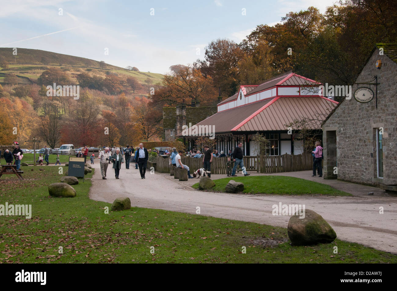 People of all ages (visitors) enjoying day out by scenic countryside cafe (Cavendish Pavilion) - Bolton Abbey Estate, - Stock Image