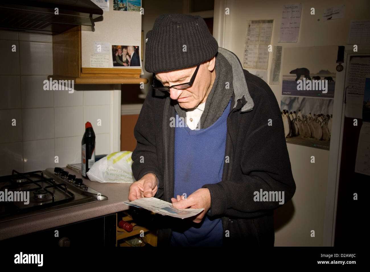 An Elderly man looking at his Building Society Book. - Stock Image