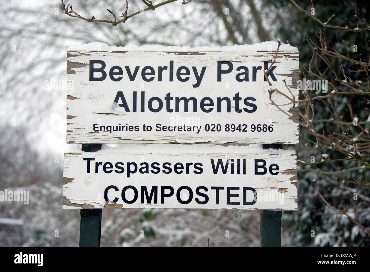 An allotment sign warning that trespassers will be composted. - Stock Image