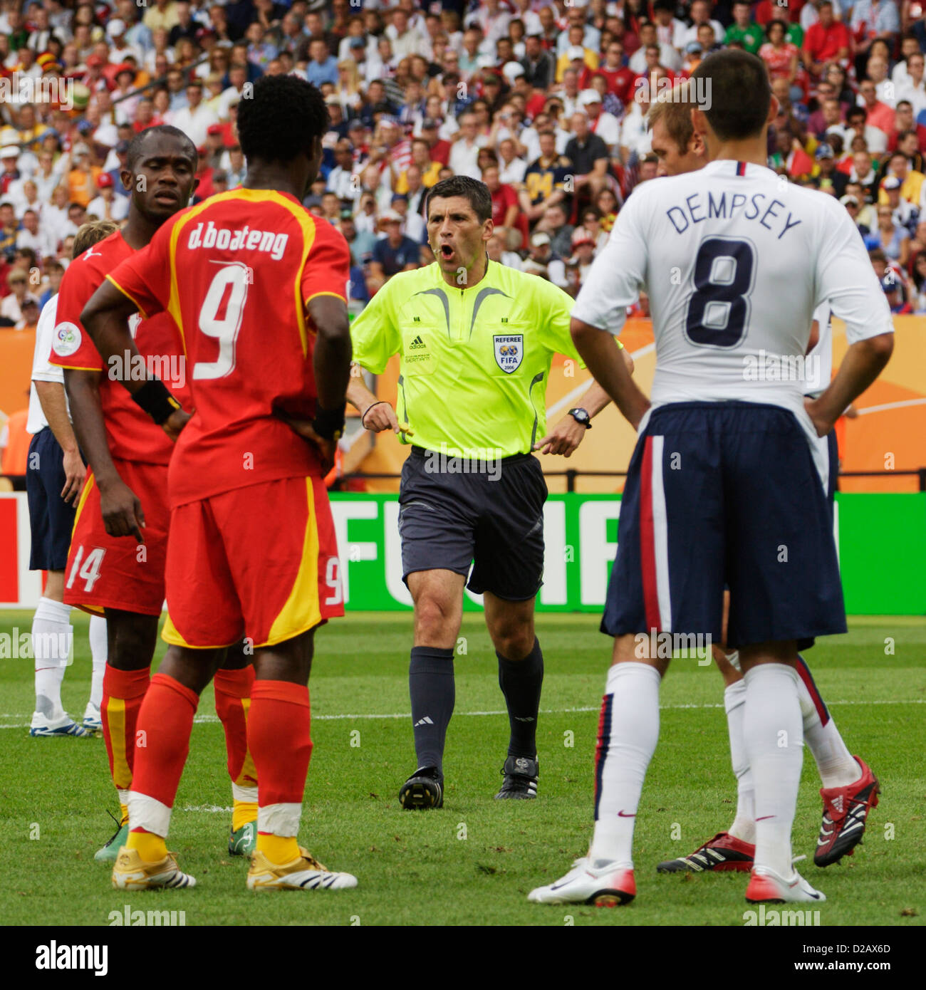 Referee Markus Merk (GER) cautions players during the FIFA World Cup Group E match between Ghana and the United States. Stock Photo