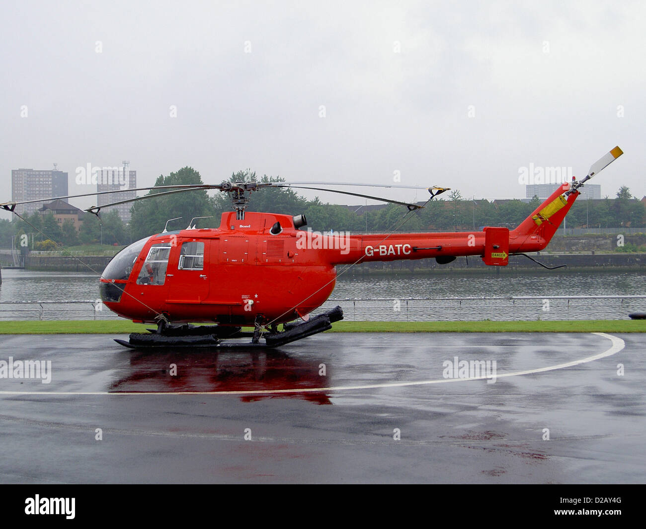 Helicopter G-BATC (Bolkow Bo105) at Heliport Airport (EGEG) in Glasgow, England - Stock Image