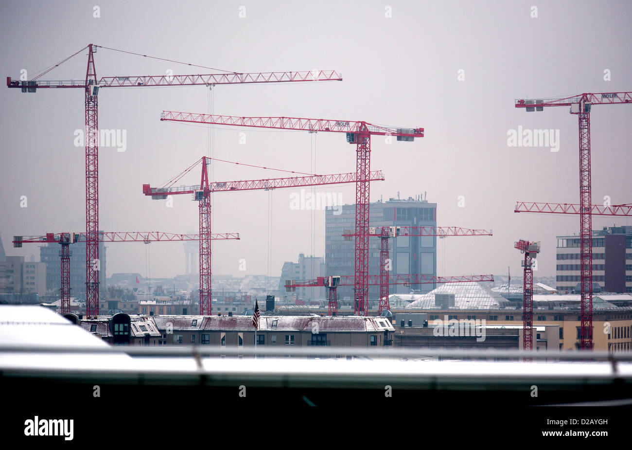 Cranes stand on a construction site in Berlin, Germany, 15 January 2013. Robust economic growth in 2012 has been - Stock Image