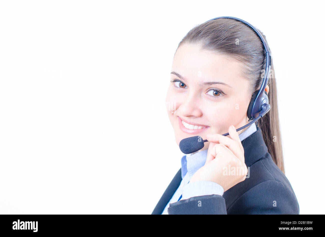 Female customer service representative at her desk - Stock Image
