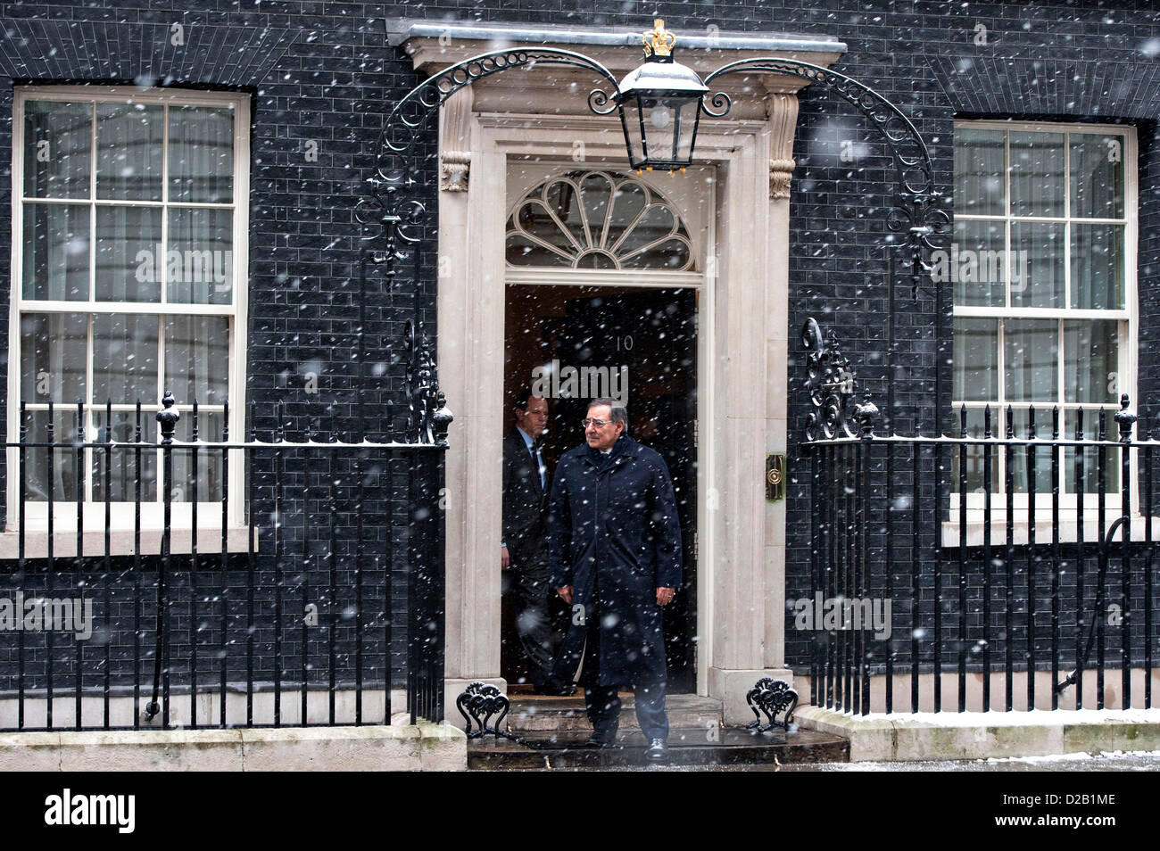 US Secretary of Defense Leon Panetta exits 10 Downing Street on a snowy day after a meeting with British Prime Minister - Stock Image