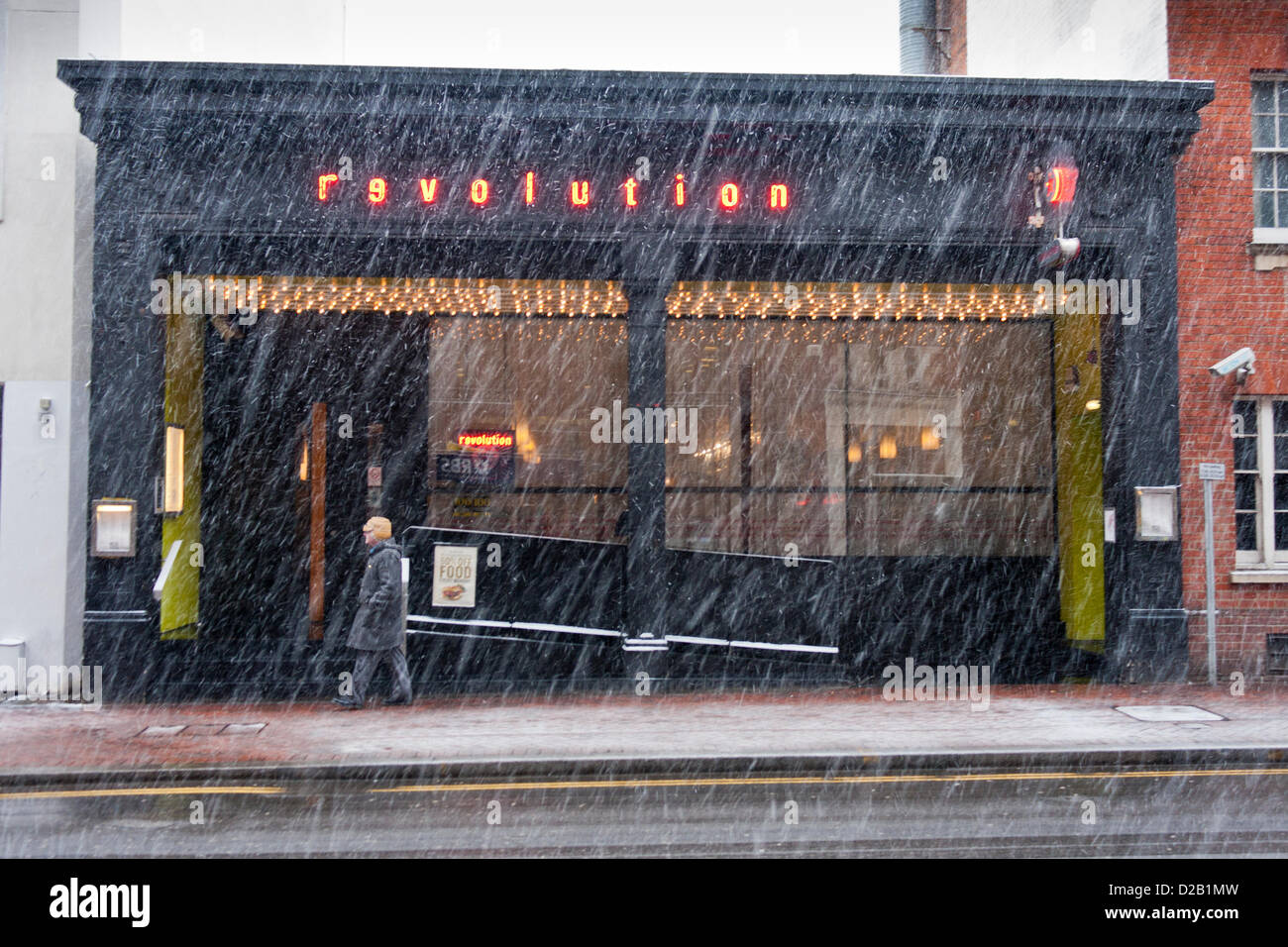 18th January 2013. Reading, Berkshire, UK. A pedestrian in the town centre braves blizzard conditions as increasingly - Stock Image