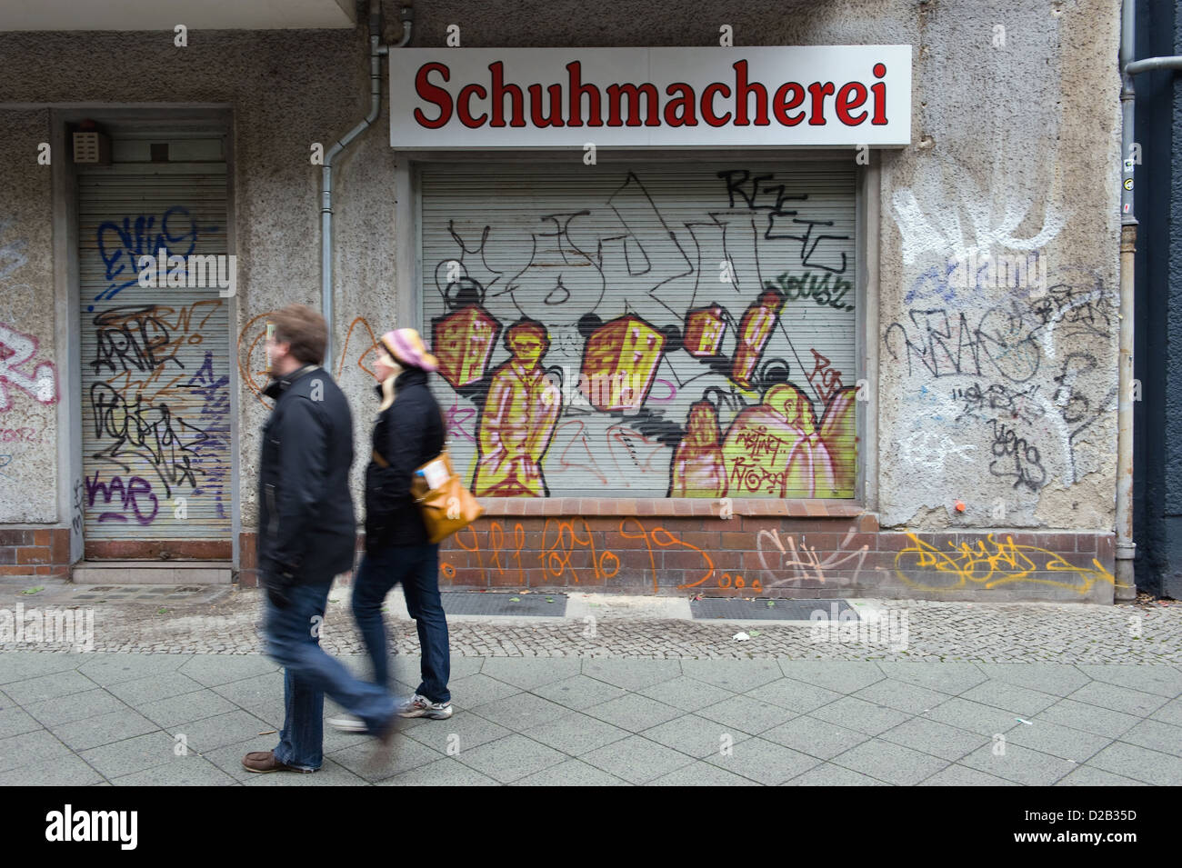 Berlin, Germany, graffiti on a lowered blinds of a shoemaker - Stock Image