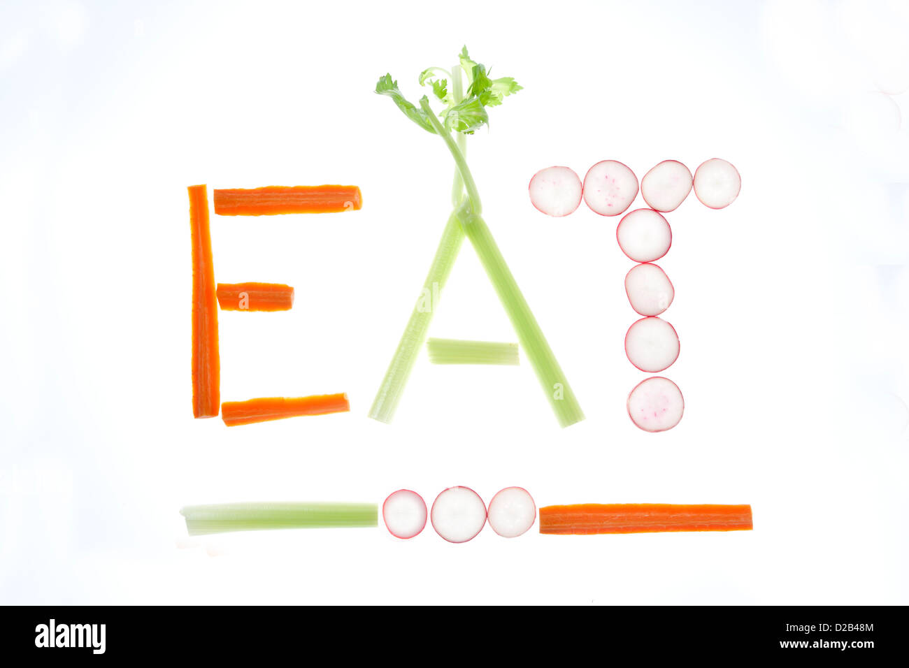 A conceptual image of carrots, celery, and radishes spelling out eat. - Stock Image