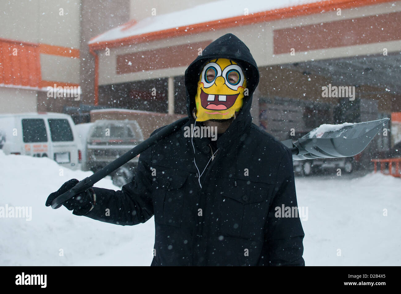 CHICAGO - FEB 2: A man takes a break from shoveling snow following a massive winter storm on February 2, 2011 in - Stock Image
