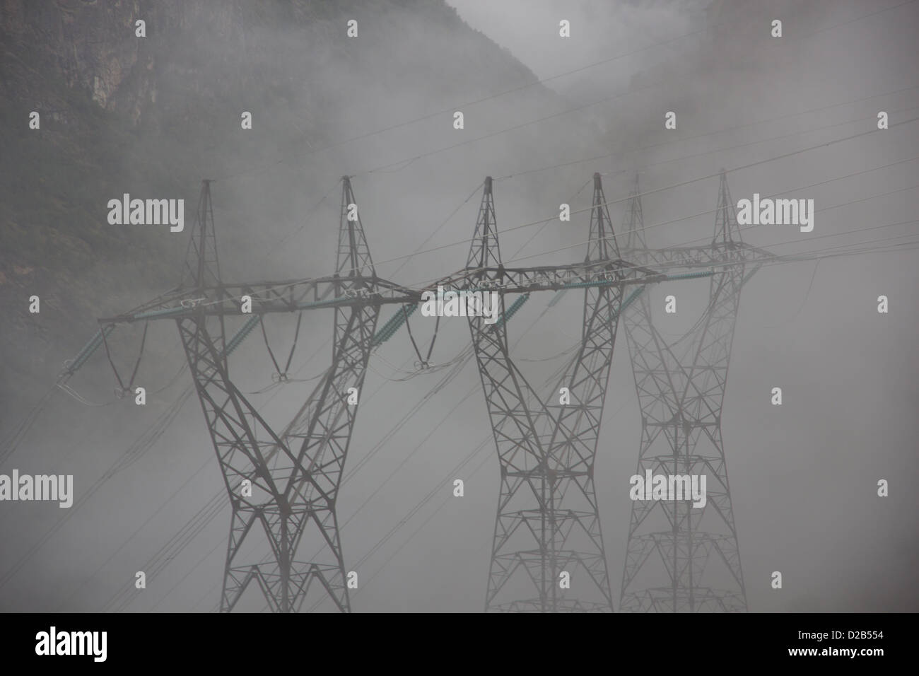 Picture of some powerlines in fog - Stock Image