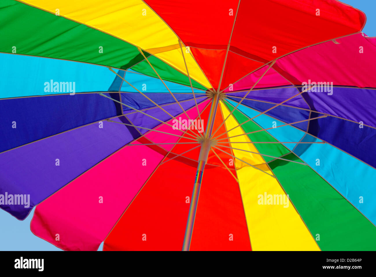 Close-up view from under a bright rainbow colored umbrella Stock Photo