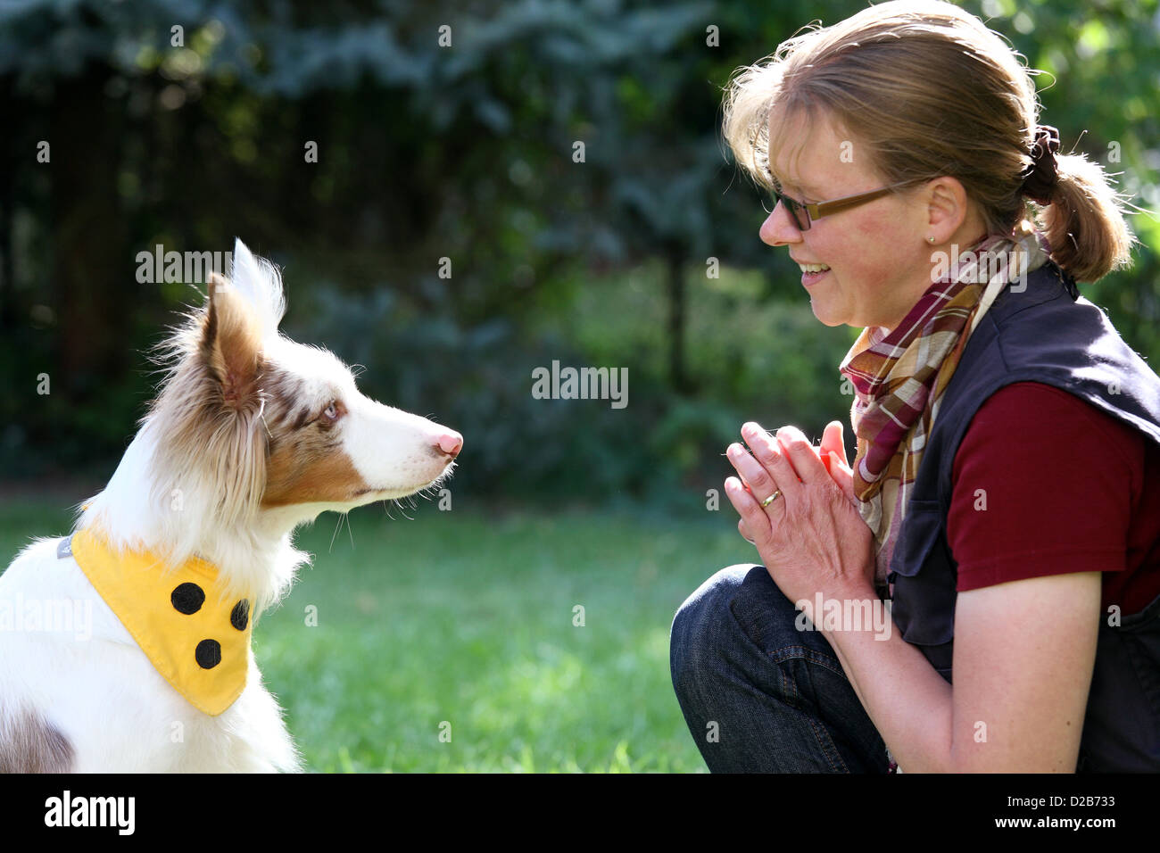 Berlin, Germany, the dogs physiotherapist Petra Herrmann and her dog Sky - Stock Image