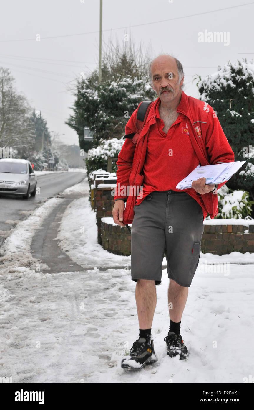 Snow  Berkshire UK 19.01.2013  'Hardy' Earley Postman Brekk  Darney  still wears his shorts all year round - Stock Image