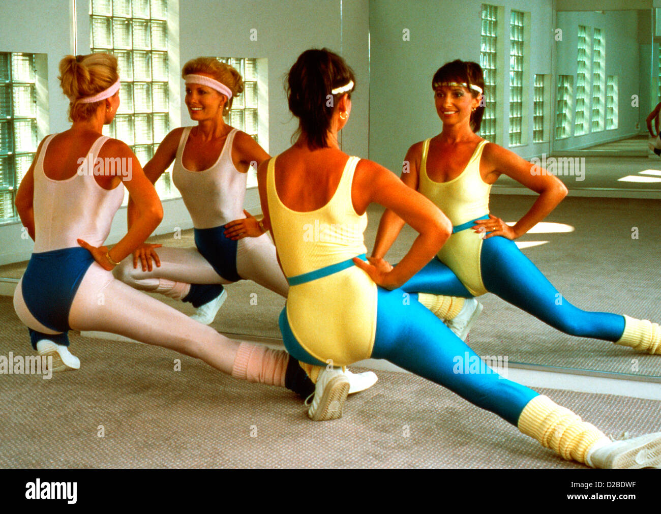 1980 s two women in workout clothes doing aerobics stock photo