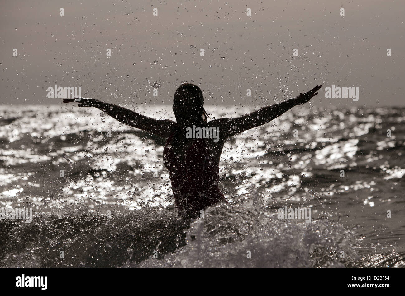 Kägsdorf, Germany, silhouette, woman jumps out of the sea Stock Photo