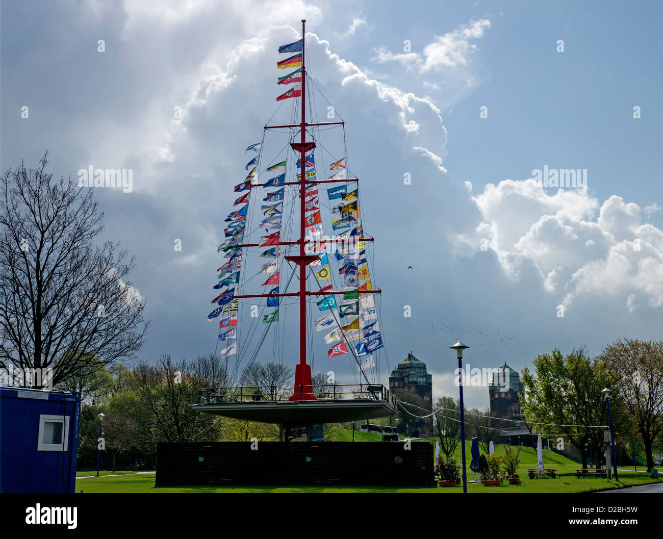 Flagpole with company flags on Muehlenweide by the river Rhine, Duisburg, Germany - Stock Image
