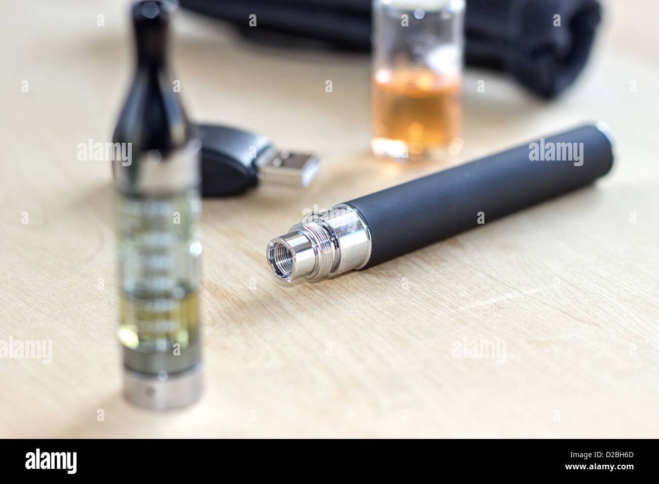 Black electronic nicotine inhalator on table - Stock Image