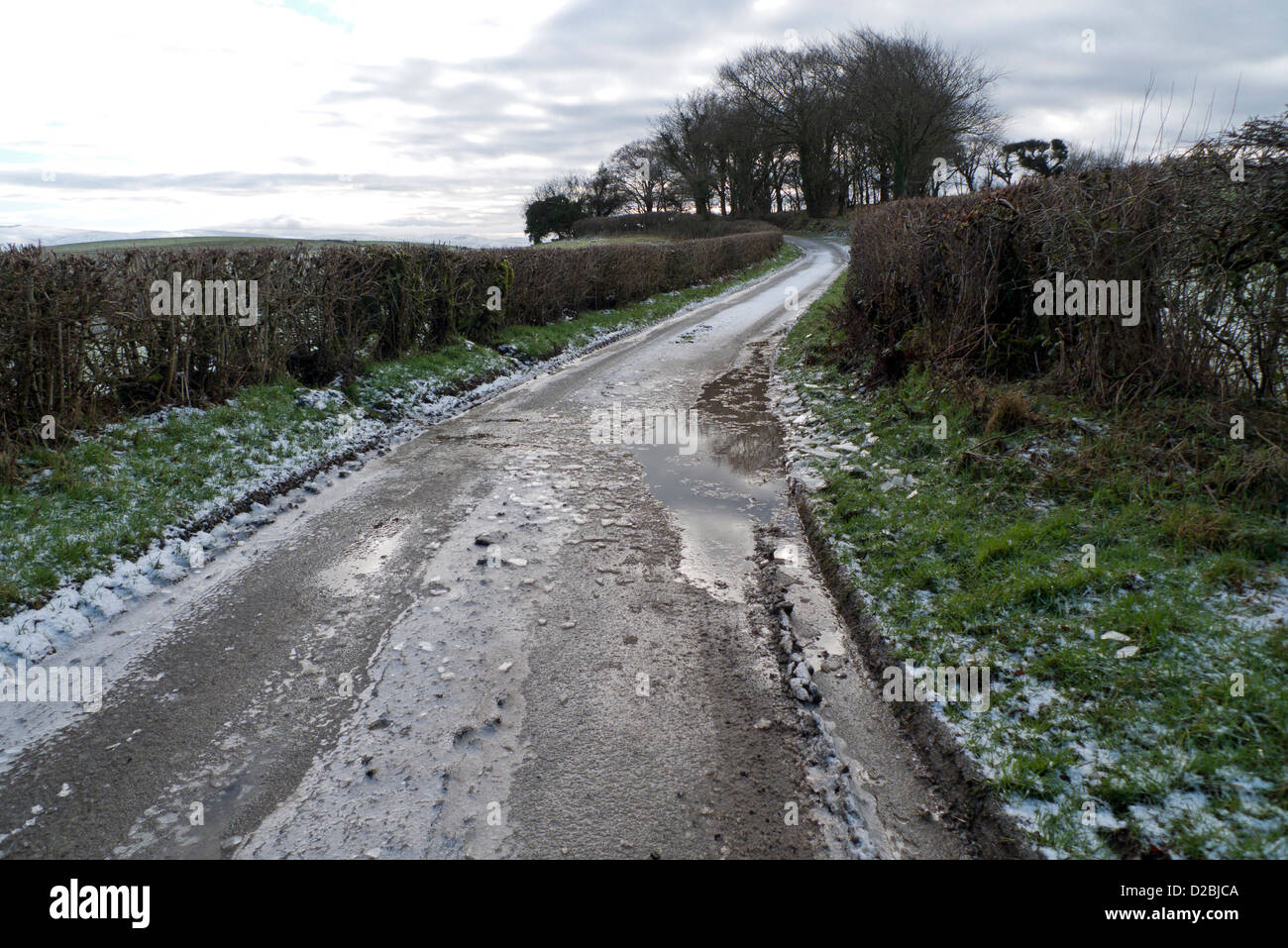 Icy rural country road in winter in Carmarthenshire, West Wales, UK  KATHY DEWITT - Stock Image