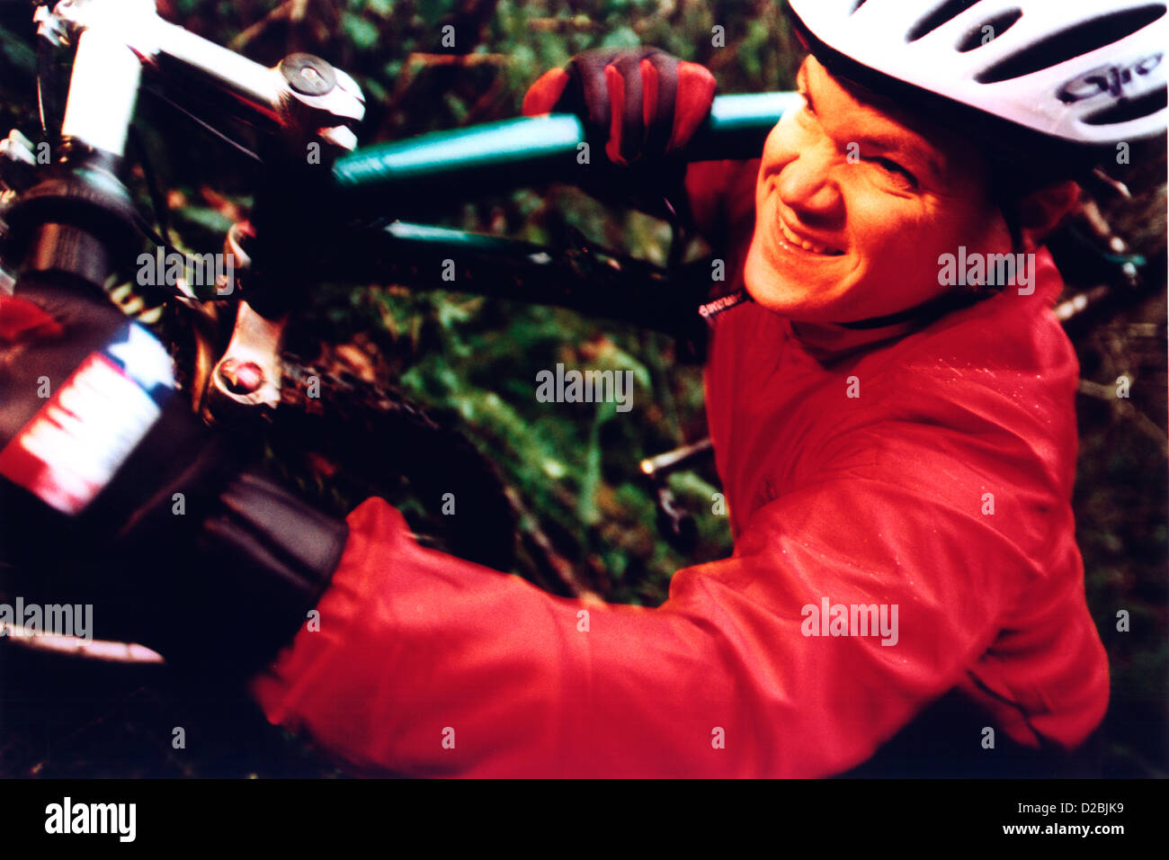 Male Mountain Biker Climbing Mountain. *Restricted Use - Stock Image