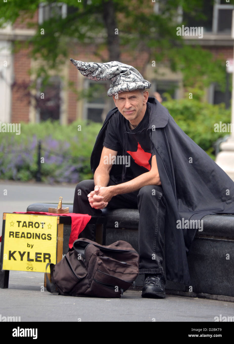 Tarot card reader Kyler in Washington Square Park in Greenwich Village, New York City Stock Photo