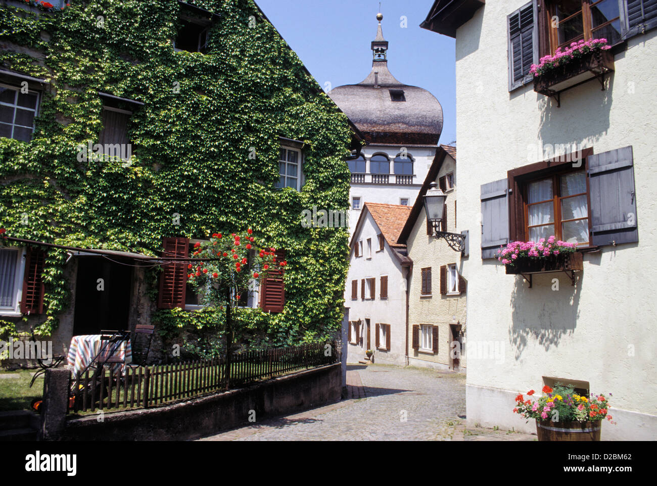 Austria, Bregenz, Upper Town. Street Scene With St. Martin'S Tower In Background. Stock Photo